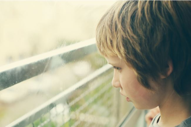 Autistic child looking out of the window