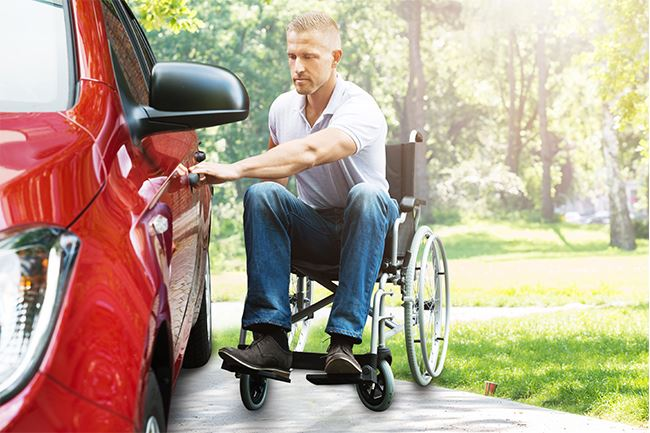A man in wheelchair open a Motability car door.